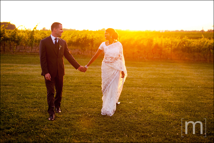 a photo of the couple walking at a wedding at sue ann staff winery in niagara on the lake