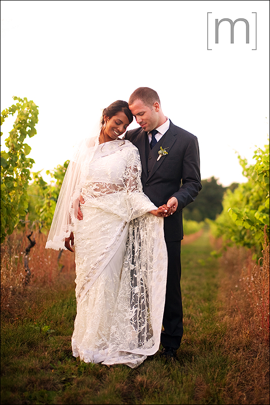 a photo of the couple at a wedding at sue ann staff winery in niagara on the lake