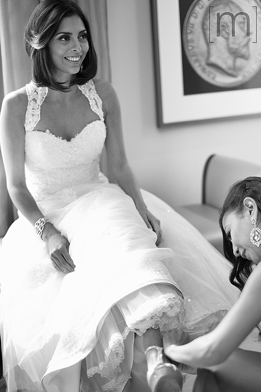 a wedding photo of the bride getting ready at king edward hotel toronto