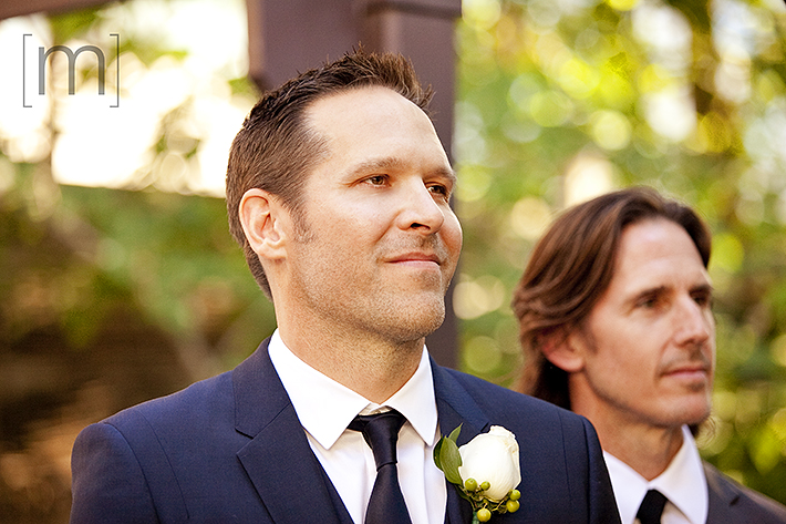 a wedding photo of the groom smiling at the ceremony at berkeley field house toronto