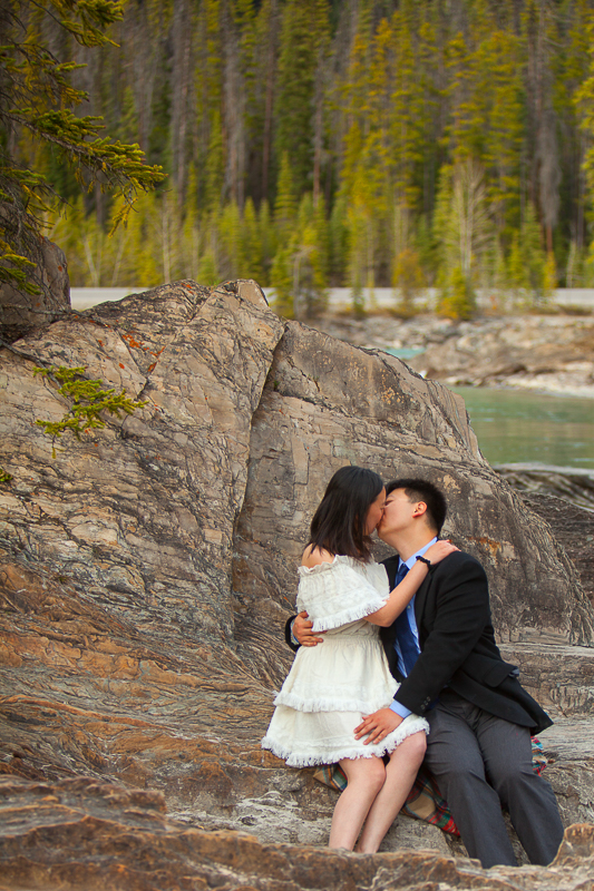 a photoshoot of a couple kissing at an engagement at emerald lake at yoho park in bc