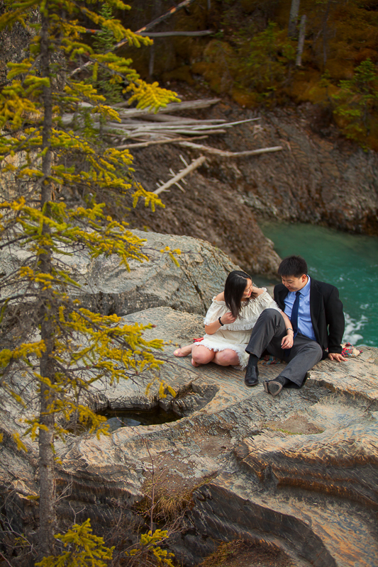 a photoshoot of a couple sitting at an engagement at emerald lake at yoho park in bc