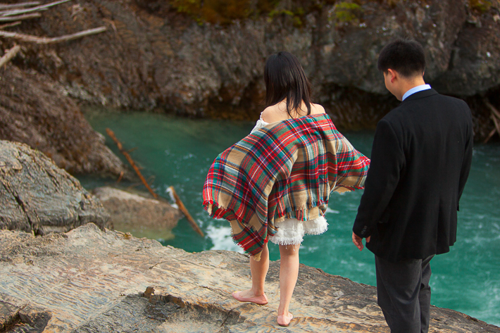 a photoshoot of a couple walking at an engagement at emerald lake at yoho park in bc