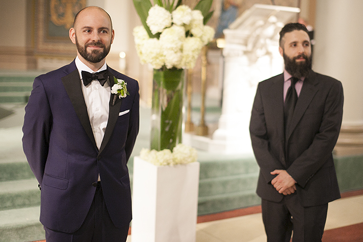 a photo of the groomsmen waiting at a ceremony at st pauls basilica toronto