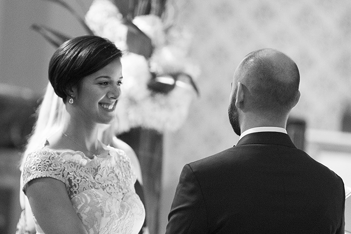 a photo of the ceremony vows at a wedding at st pauls basilica toronto