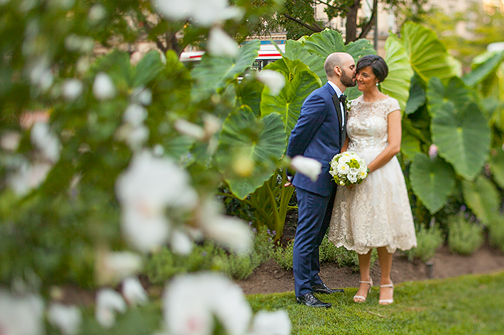 a photo of the couple in a rose garden at a wedding at st james park toronto