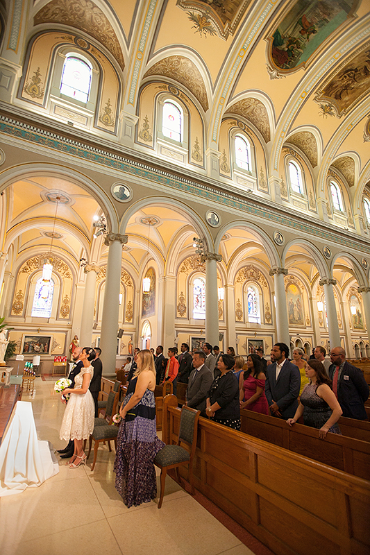 a photo of the ceremony guests at a wedding at st pauls basilica toronto