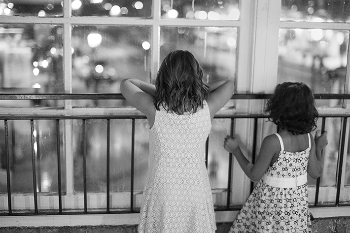 a photo of kids looking out the window at a wedding at st lawrence market toronto