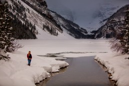 a photoshoot of a mother to be in winter in lake louise alberta