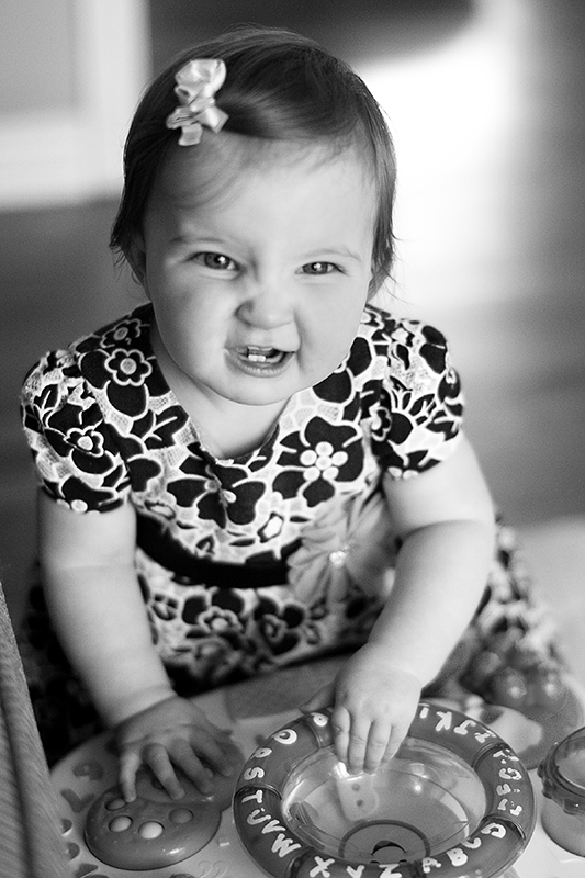 a photo of a baby laughing at a fall family session in uxbridge ontario