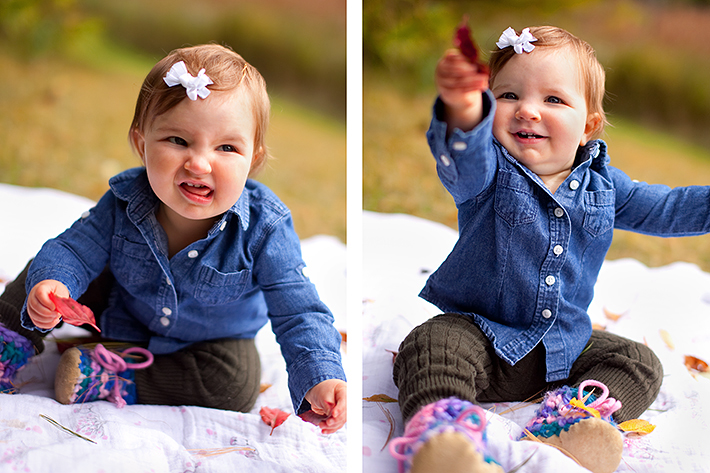 a photo of a baby sitting throwing leaves at a fall family session in uxbridge ontario