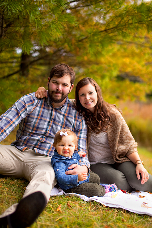 a photo of parents sitting on a blanket at a fall family session in uxbridge ontario