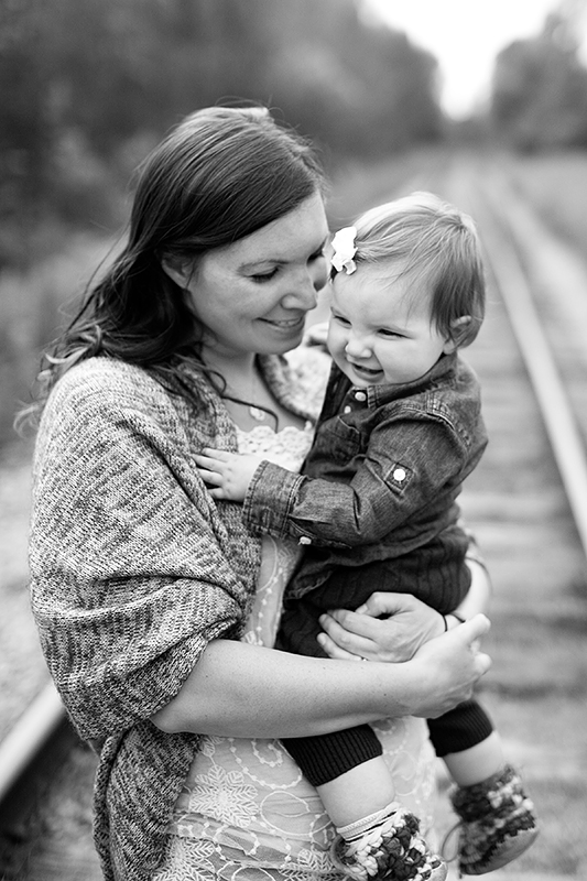a photo of a mother laughing with her baby at a fall family session in uxbridge ontario