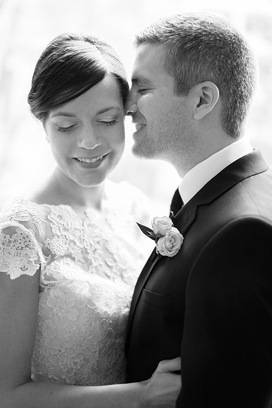 a photo of a bride and groom cuddling at a wedding at the rosewater toronto
