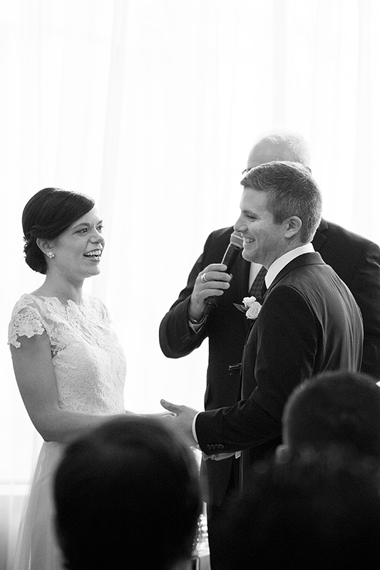 a photo of a bride and groom laughing at the ceremony at a wedding at the rosewater toronto