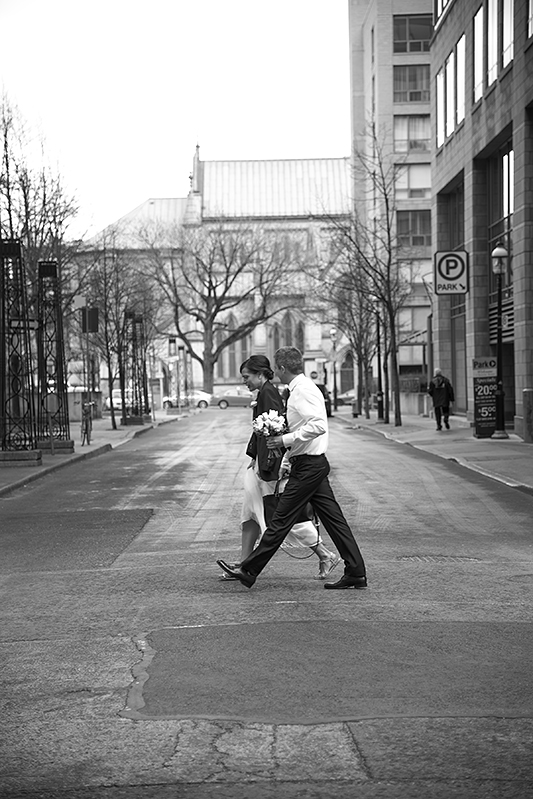 a photo of the bride and groom walking down the street at a wedding at the rosewater toronto