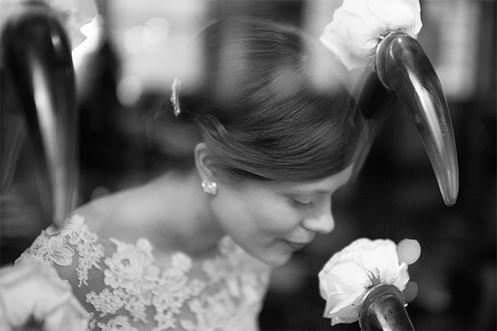 a portrait of the bride through a glass rose wall at a wedding at the rosewater toronto