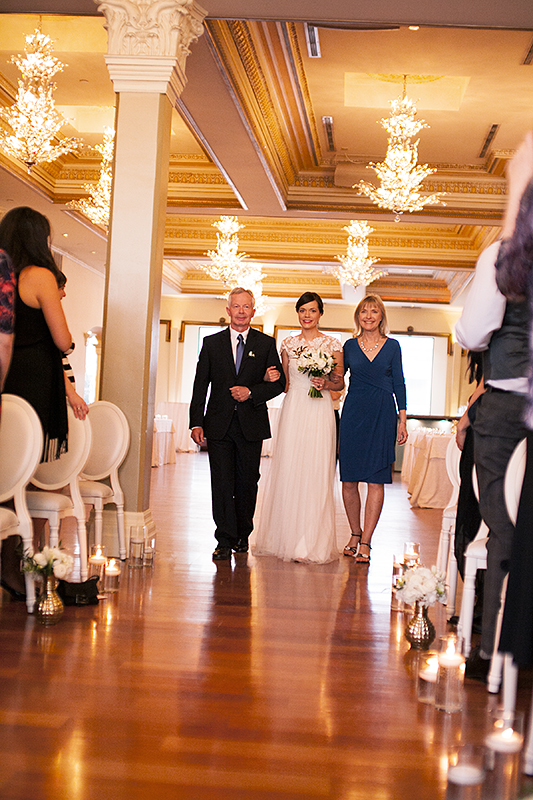 a photo of a bride walking down the aisle at the ceremony at a wedding at the rosewater toronto