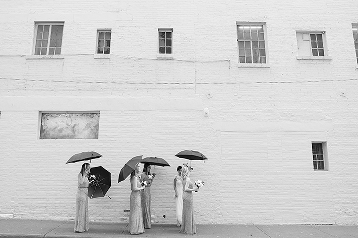 a photo of the bridesmaids walking out of the king edward hotel at a wedding in toronto