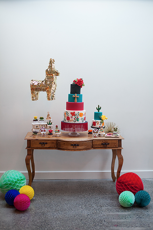 a photo of the colourful cake table details at a frida inspiration wedding in vancouver