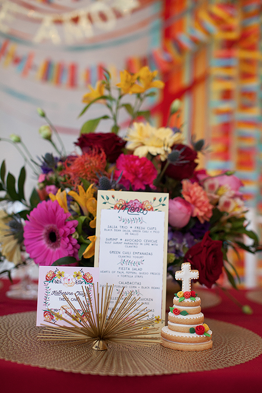 a photo of the invites and mini cake details at a frida inspiration wedding in vancouver