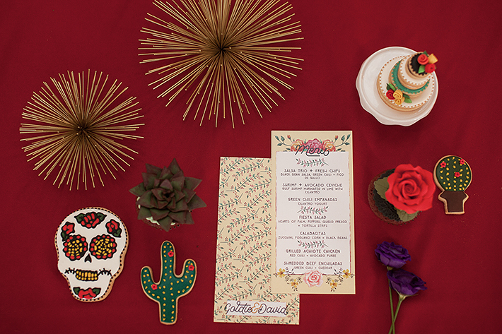 a photo of the details on a red backdrop at a frida inspiration wedding in vancouver