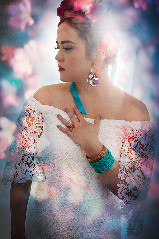 a bridal portrait with colourful flower backdrop at a frida inspiration wedding in vancouver