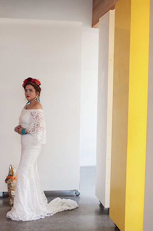 a bridal portrait with gold pinata at a frida inspiration wedding in vancouver