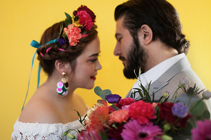 a photo of a bride and groom snuggling at a frida inspiration wedding in vancouver