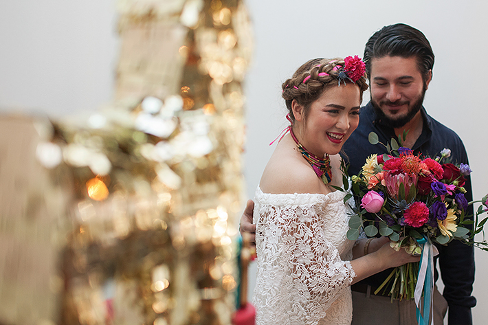 a photo of a bride and groom laughing at a frida inspiration wedding in vancouver