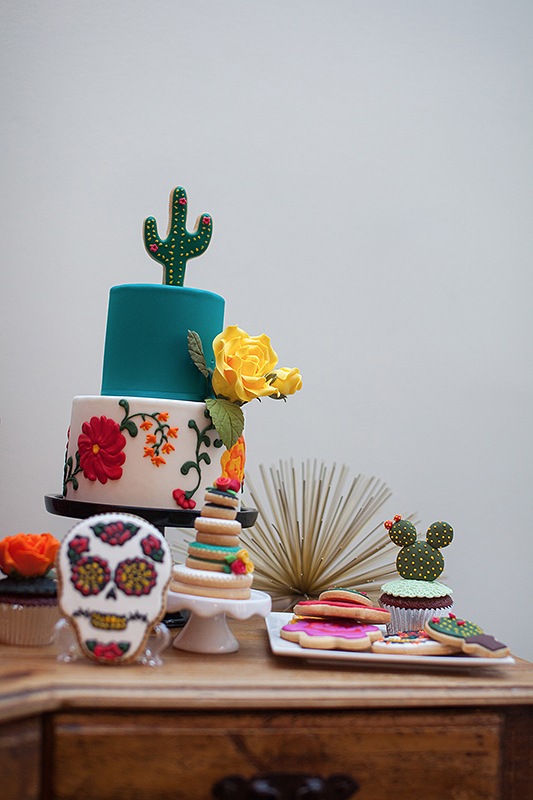 a photo of the colourful cactus cake table details at a frida inspiration wedding in vancouver