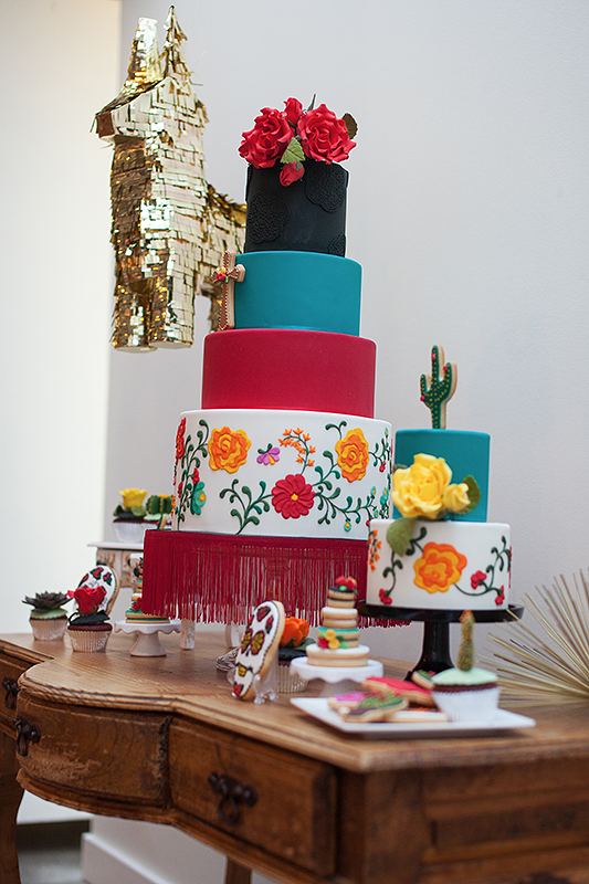 a photo of the colourful cake table details gold piñata at a frida inspiration wedding in vancouver