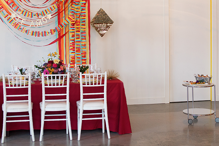 a photo of a table with a colourful backdrop te amo at a frida inspiration wedding in vancouver