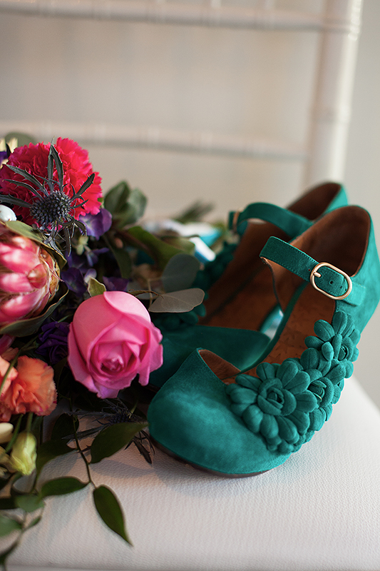 a photo of teal bridal shoes at a frida inspiration wedding in vancouver