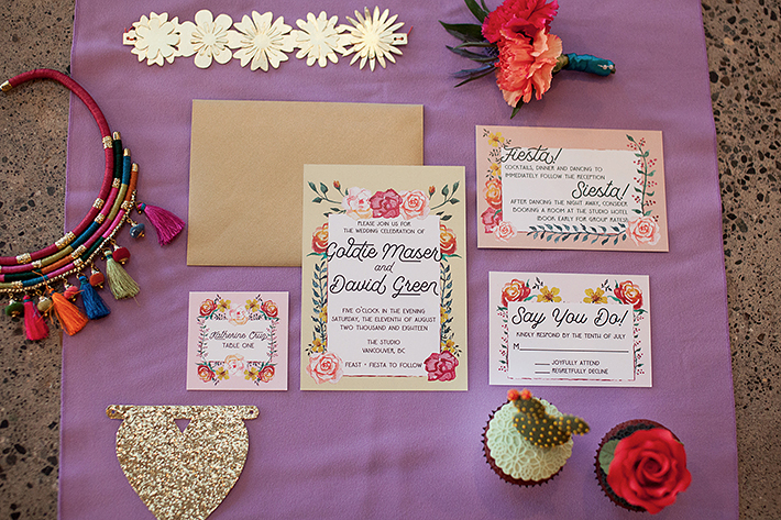 a photo of the table details invites at a frida inspiration wedding in vancouver