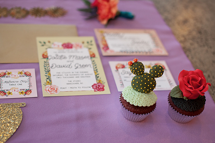 a photo of the table details mini cakes at a frida inspiration wedding in vancouver