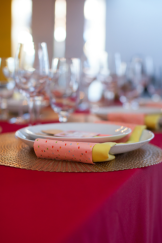a photo of the colourful table details gold placemats at a frida inspiration wedding in vancouver