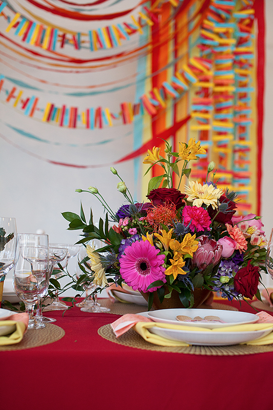 a photo of the colourful table with flowers at a frida inspiration wedding in vancouver