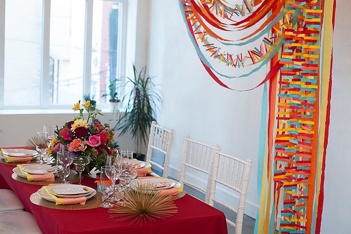 a photo of a table with a colourful backdrop at a frida inspiration wedding in vancouver
