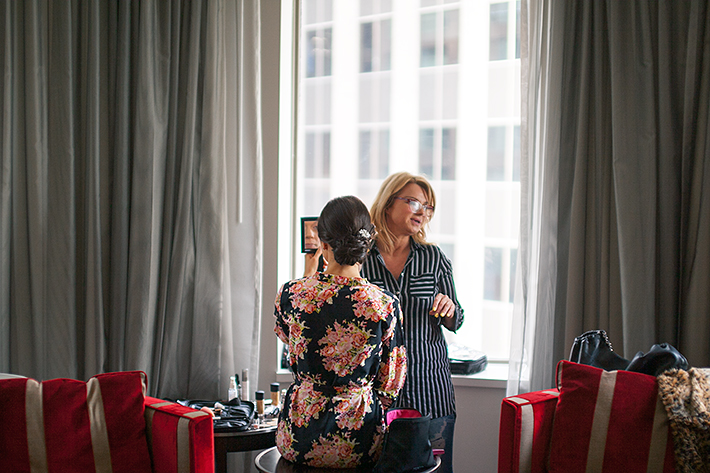 a photo of the bride getting ready at king edward hotel at a wedding in toronto