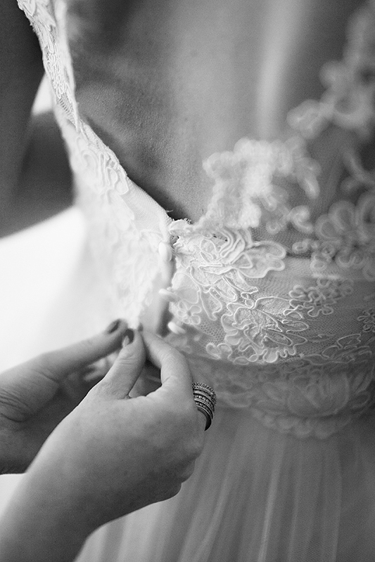a photo of the bride getting her dress on at king edward hotel at a wedding in toronto