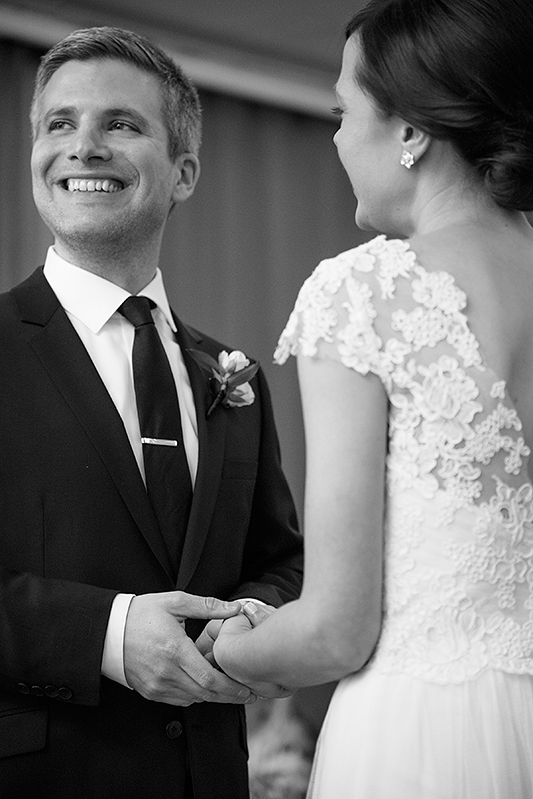 a photo of the groom holding the bride's hands at the ceremony at a wedding at the rosewater toronto