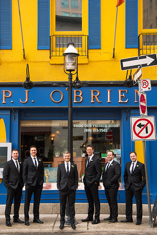 a photo of the groomsmen outside of a pub at a wedding in toronto