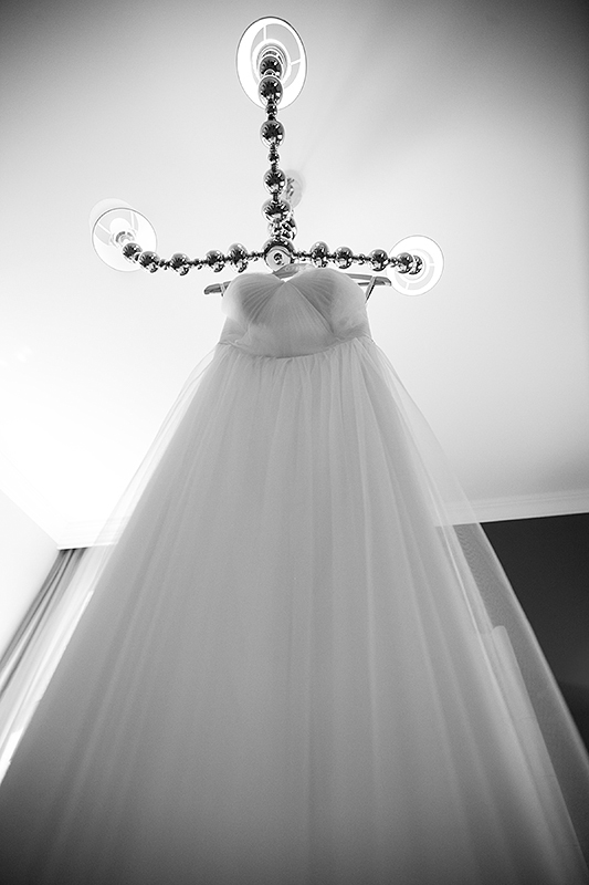 a photo of the bride's dress hanging at king edward hotel at a wedding in toronto