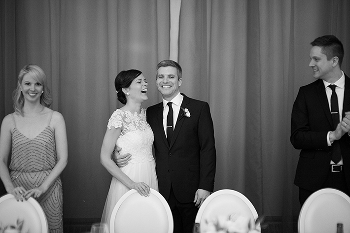 a photo of a bride and groom laughing at a wedding reception at the rosewater toronto