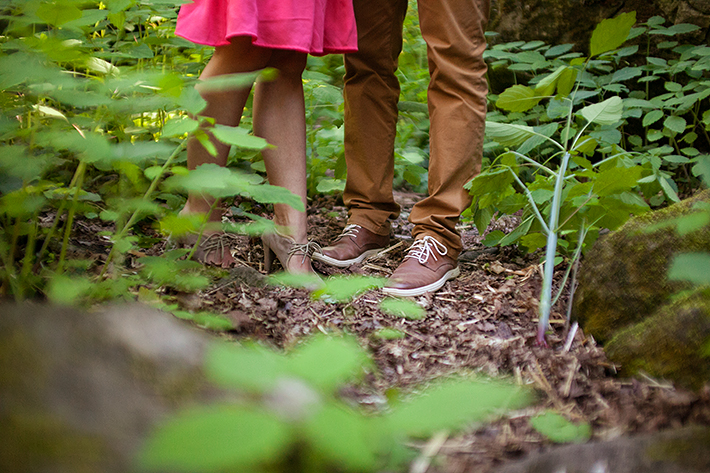 a photo of the couples feet in the forest at a summer engagement in balls falls ontario
