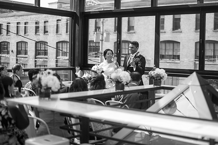 a photo of the couple toasting at a wedding ceremony at gusto restaurant in toronto