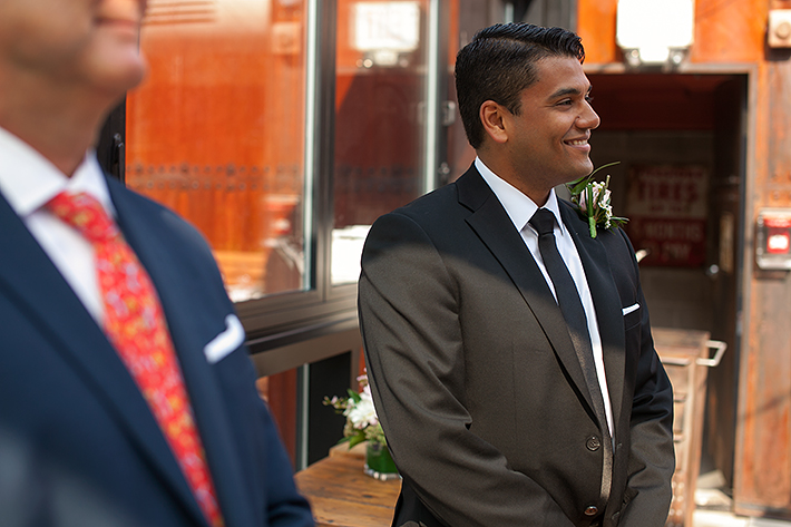 a photo of the happy groom at a wedding ceremony at gusto restaurant in toronto