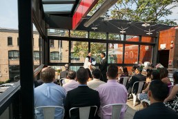 a photo of the wedding ceremony at gusto restaurant in toronto