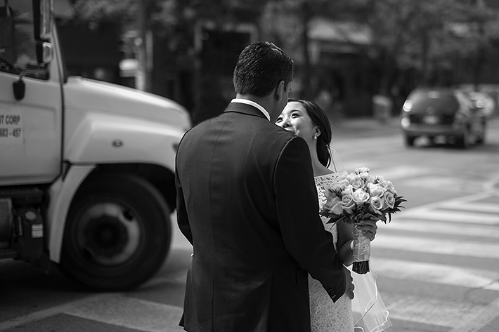 a photo of the couple holding each other in front of a truck at a wedding in toronto